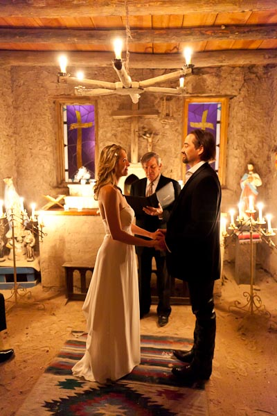 Bride and Groom exchange vows in the 200 year-old chapel at the Hacienda Vargs