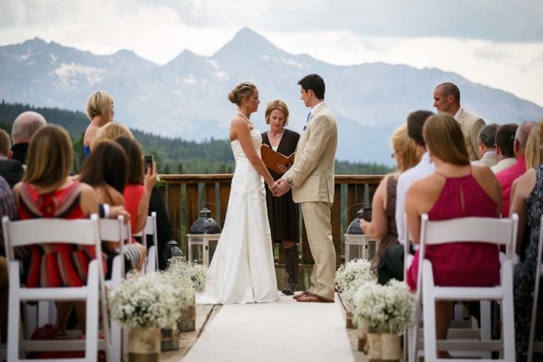 Looking down the aisle of a beautiful mountain wedding in Telluride with Mt Wilson looming in the background