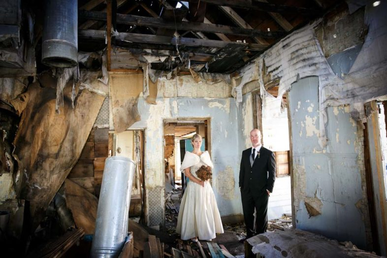 Portrait of the newlyweds in a condemned house