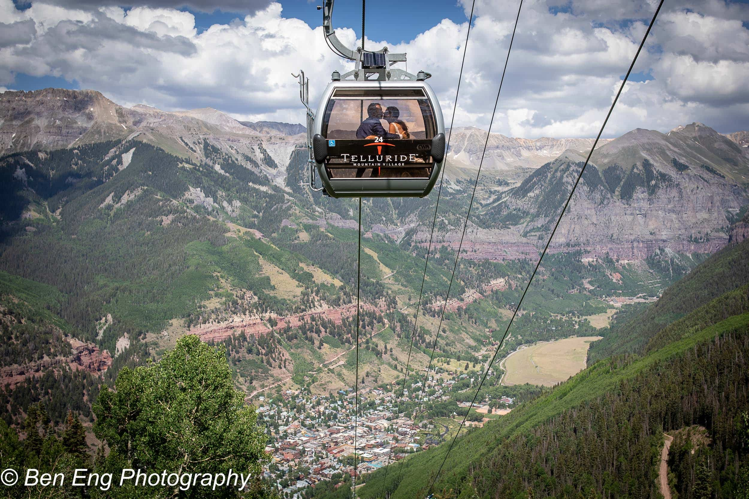 Bride and groom in the gondola above Telluride