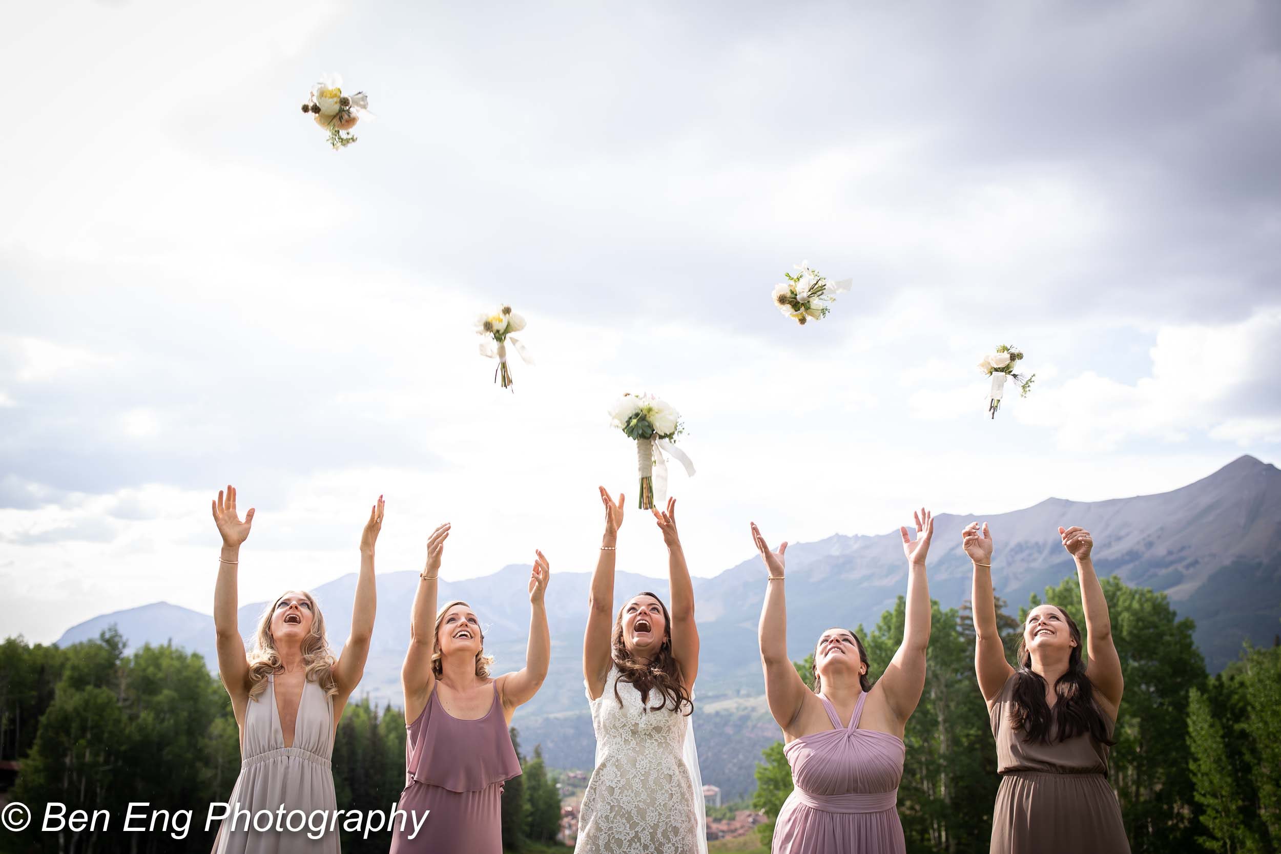 The bridesmaids tossing their bouquets