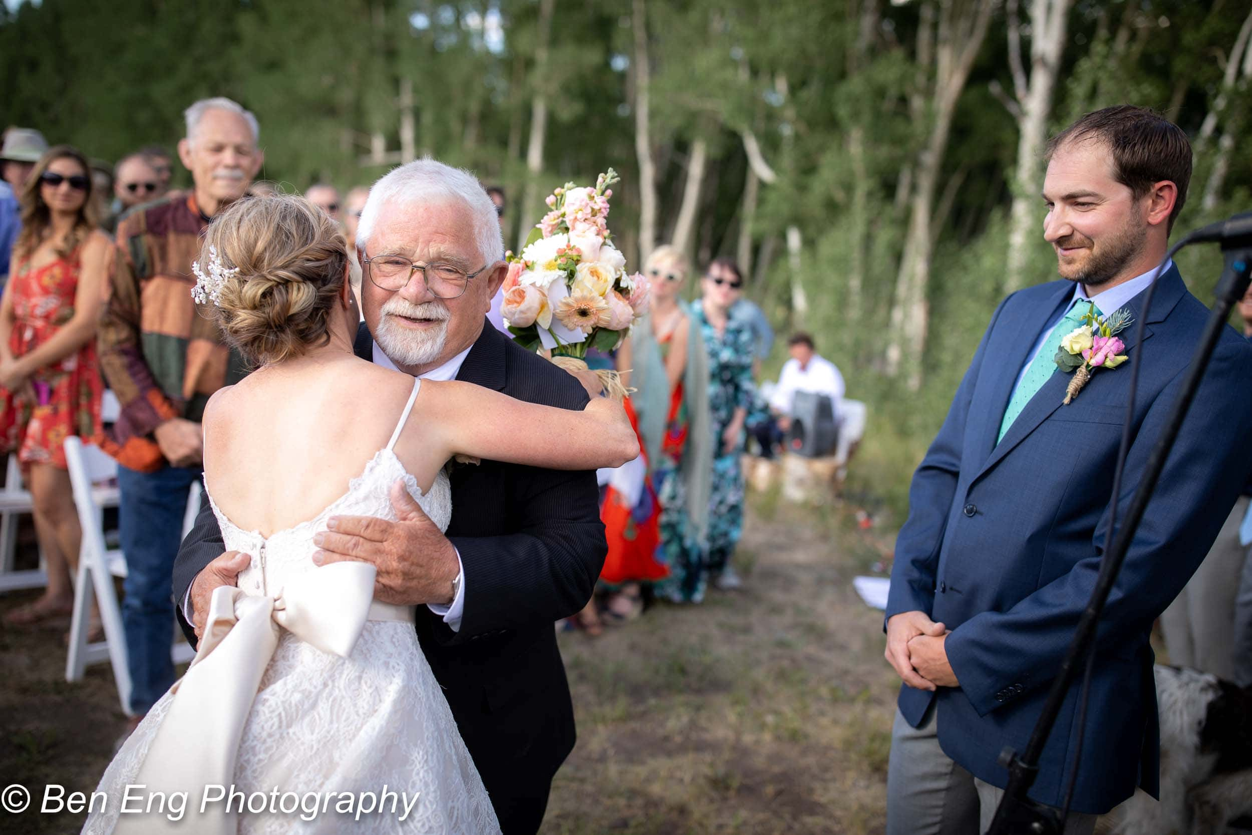 father of the bride giving her away
