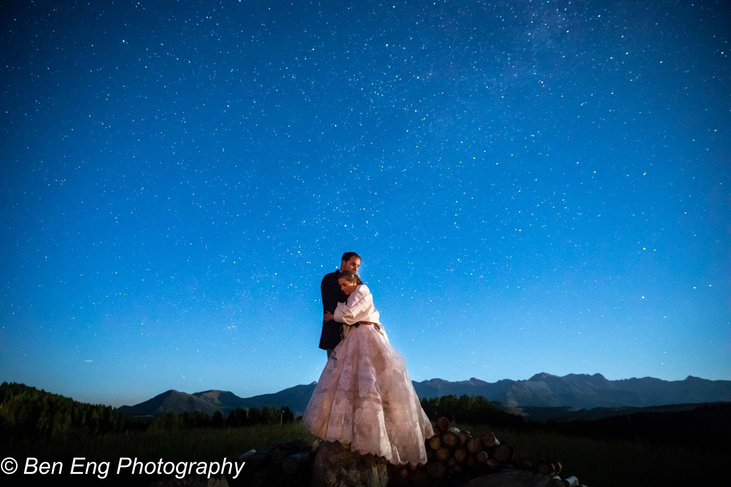 portrait of the newlyweds under the night sky at the schmid ranch by Telluride wedding photographer Ben Eng