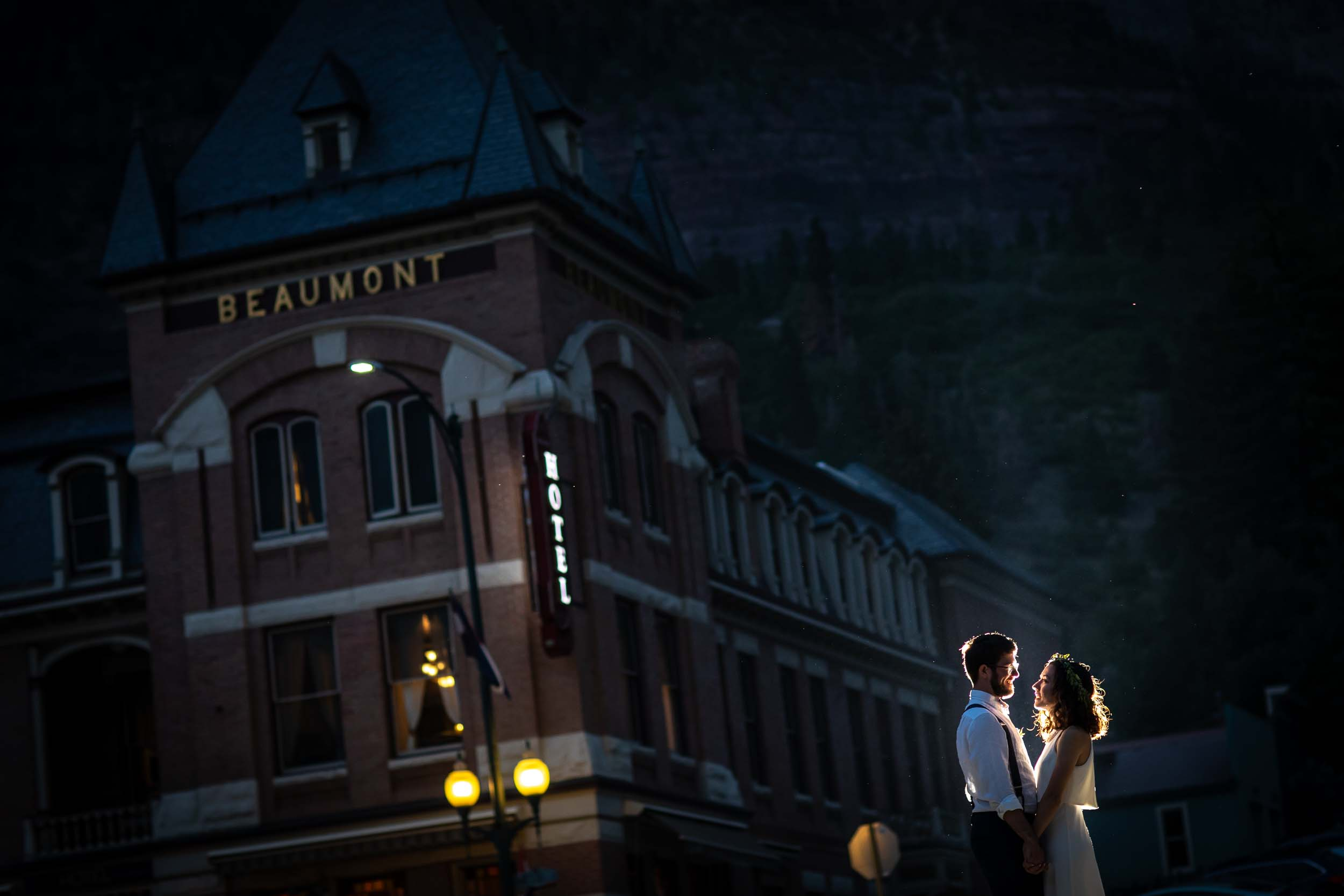 Bride and groom portrait in front of the Beaumont Hotel in Ouray, CO