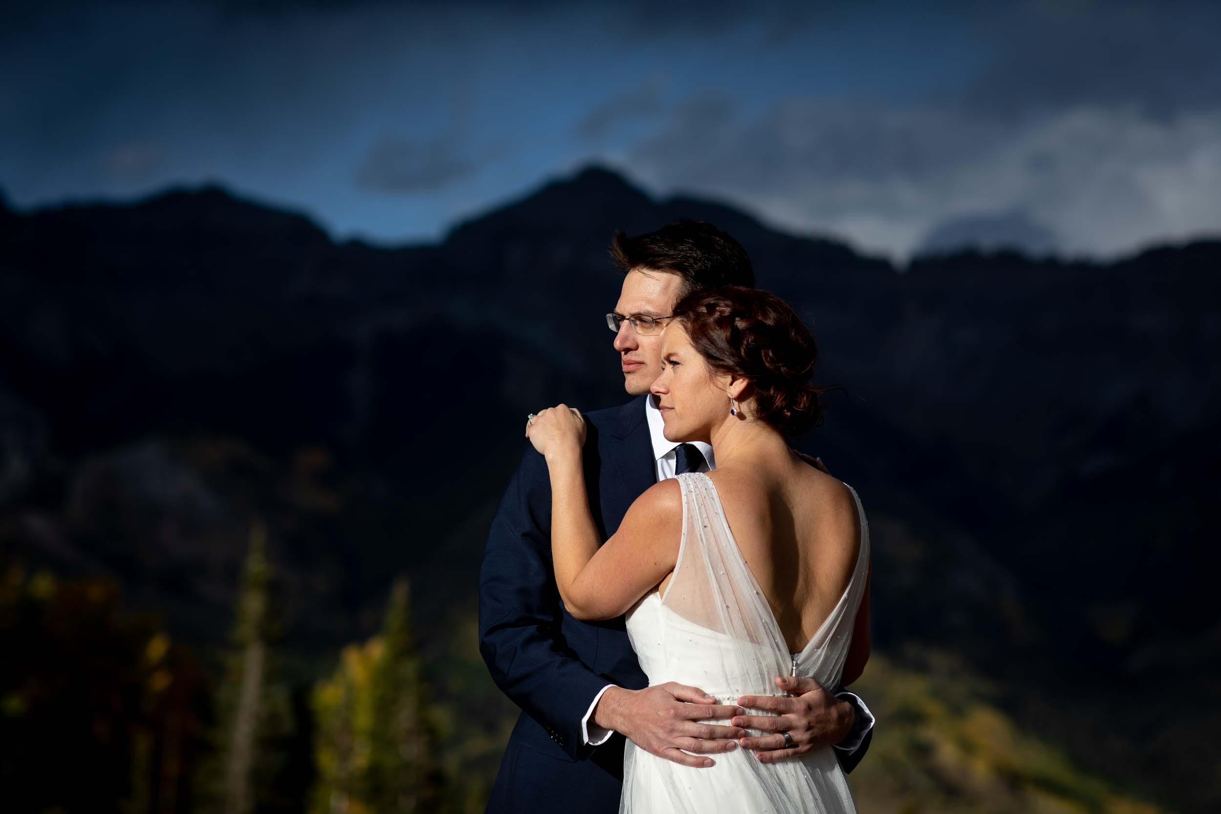 Bride and Groom portrait in front of the San Sophia ridge