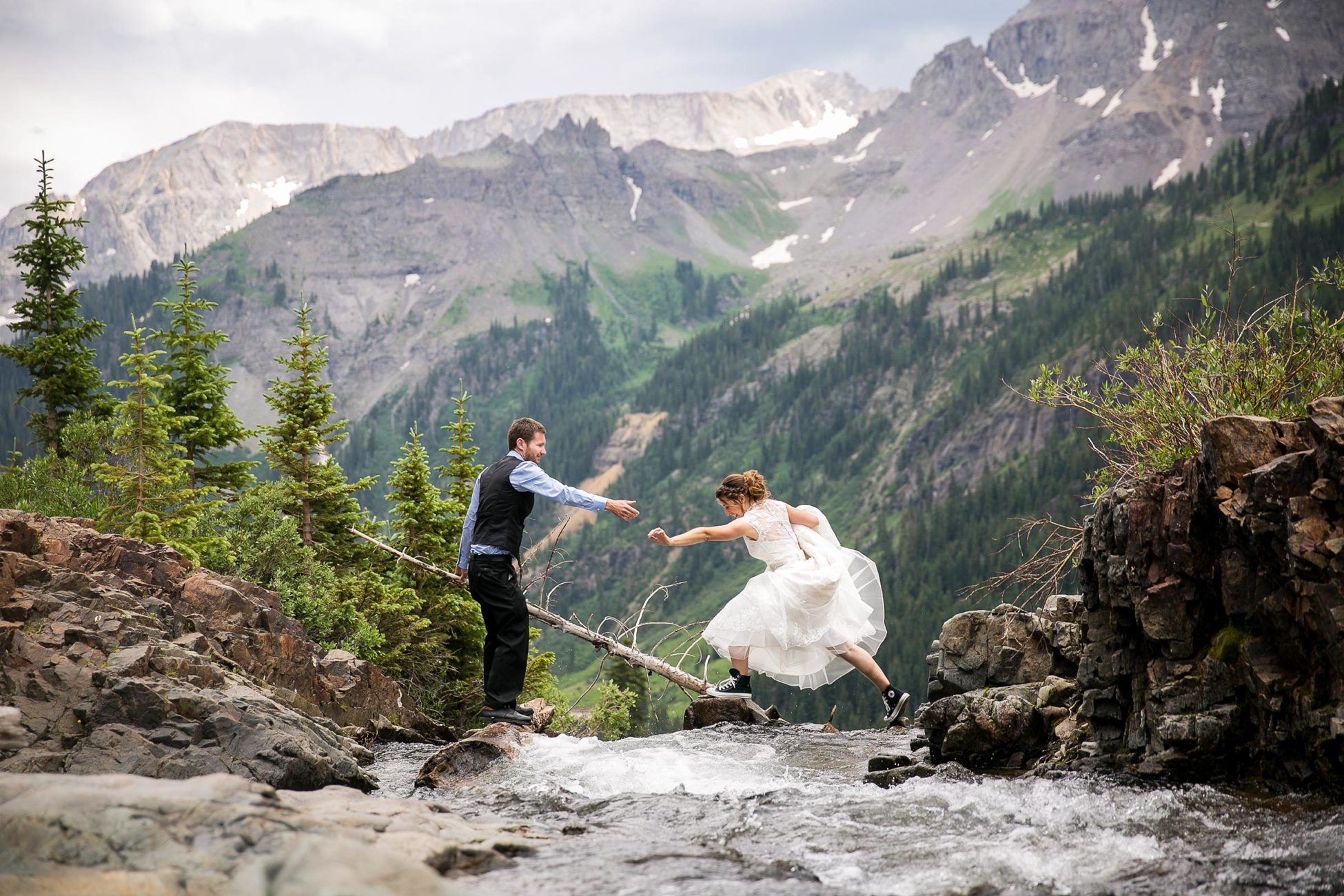 Matt and Angela's outdoor Colorado mountain wedding in Ouray, CO. Floral arrangements by Judi Folga of Willow Creek Floral, music by Funkdafari, and photo booth from Telluride wedding photographer Ben Eng.