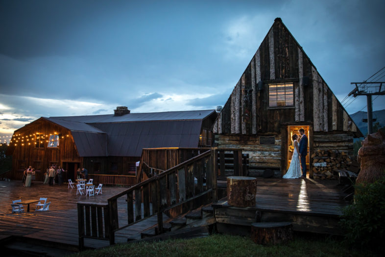 A rustic-stlyle photograph of a Telluride wedding at the San Sophia overlook and Gorrono ranch